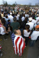 Richard DeOlivas, 42, a United States citizen, is wrapped in an American flag and stands with an...