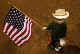 (Denver, CO., January 13, 2004) Cade Arnette, 3, holds a flag before competing in the stick horse...