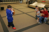 Upon his arrival at DIA, Vincent Sanchez, cq, 9, takes a photograph of his cousins Joey Quintana,...