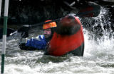 Chris Popovich (cq) practices his rolls at the Clear Creek Whitewater park in Golden, Colorado...