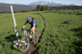 A rider competes in the 2005 Durango MTB 100. The race covers miles of terrain that that begins at...