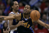 Denver Nuggets center, Marcus Camby, right, boxes out Los Angeles Clippers' guard Shaun...