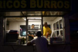 Jose Granillo, inside left, and Elio Flores, inside right, work at Primavera Taco, a taco-vending...