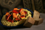 This is a bed of cous cous topped with vegetables at Mataam Fez in Denver, Colorado. (JUDY...