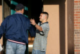 Alex Avila, 17, greets law enforcement advocate Jesse Ramirez (cq) as Ramirez approaches the house...