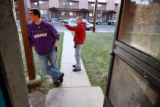 Brian Brown (cq), left, and Joey Gasca wait outside a Denver home during a house check Friday,...