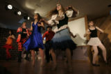 "The cast dances in the final scene of ""No Strings Attached'.  It is a musical adaptation of..."