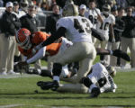 Bowling Green State University quarterback Omar Jacobs (#4) gets yardage on this play against...