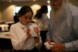 Alexius Jennings, cq, 12, and her father Mike Jenneings prepare bowls for the passover seder,...