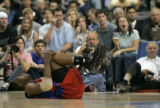Los Angeles Clippers forward Elton Brand finds himself on his back after being fouled hard by...