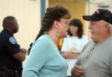 Lochbuie residents Jorgette Davis (cq), center, and Gary Kaminsky (cq), right, talk outside of...
