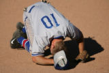Cherry Creek 3rd baseman Todd Weir is down after being hit in the face by a hard grounder in the...