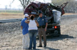 Colorado State Patrol, Cpl. Wallace Lathrop, cq, approaches Joey Resendez, cq,  and Cindy Gaytan,...