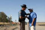 Colorado State Patrol, sgt. Thomas Iovinella, cq, comforts Joey Resendez, cq, after he returned to...