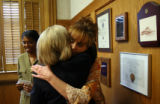 Laurie Totten (cq), right, gets a hug from Colorado First Lady Frances Owens (cq) after a press...