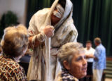 Chris Crumrine (cq) of Arvada greets the audience in character as the Leper before the first...