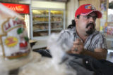 "Jose Herrera, (cq) 37, owner of ""El Paisa"" talks in his bakery on the corner of Dallas..."