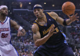 Denver Nuggets forward Kenyon Martin, right, is defended by Los Angeles Clippers player Corey...