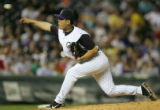 Sun-Woo Kim pitches in the 5th inning of the Colorado Rockies against the Philadelphia Phillies at...