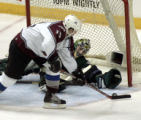 Dallas Stars goalie Marty Turco (35 - right) lays out but can't block a shot by Colorado's Andrew...