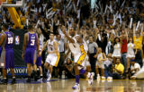 Lakers Kobe Bryant celebrates his game-winning shot in overtime against the Phoenix Suns in Game 4...