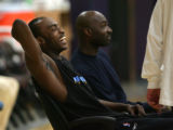Julius Hodge, who was wounded in random shooting, laughs while talking with teammates before he...