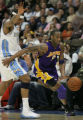 JPM594  Los Angeles Lakers Kobe Bryant, #8, drives around Denver Nuggets Carmelo Anthony in...
