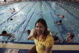 Elizabeth Sedalnick, (cq), head coach, at poolside as her swimmers warm up before practice... The...