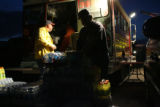 Ralph Riddle (cq), left, and David Lowe (cq) pack up drinks and supplies at the Fire Crew staging...