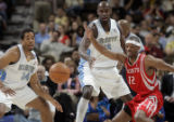 Houston Rockets' guard Rafer Alston, right, loses control of the ball being defended by Denver...