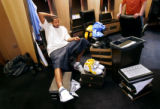 Denver Nuggets F/C Marcus Camby pauses momentarily while gathering his personal belongings...