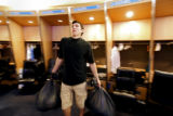 Denver Nuggets F Eduardo Najera grabs a couple of garbage bags full of his personal belongings...