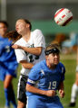 Lauren Braman, top, of Niwot, fights for a header against Kira Brannan, bottom, of Broomfield, in...