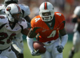10/18/03-C.W. GRIFFIN/HERALD STAFF-MIAMI- UM's widereciever Devin Hester   breaks loose and runs...