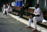 Barry Bonds sits by himself in the dugout in the bottom of the 1st inning of the Colorado Rockies...