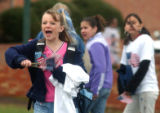 Kayla Pratt (cq), 12, waves the American flag during a  morning rally outside of Shaw Elementary...