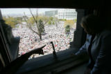 Colorado Senator Nancy Spence, R-Centennial, right, watches a river of marchers flow in to the...