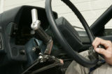 A handle on Tyler's steering wheel is customed design to help him accelerate and brake with his...