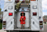 Josh Campbell-Fragoso, 4, stands on the back of the Westminster Fire Department engine truck #4...
