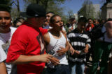 EJ218  Josef Lopez, (cq), 31, of Denver, left, in red shirt, successfully calms down Carlos Solis,...