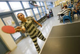 Roberto Garcia plays ping-pong in a minimum security area of the Garfield County Jail where he...
