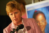 Arapahoe County D.A. Carol Chambers speaks next to a picture of Aarone Thompson (accent over e) at...