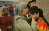 Marie Hudgens (cq), 65, a member of the Twa Pueblo Indain tribe kisses her granddaughter Rhonni...