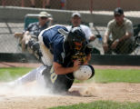 Monach's Tyler Dunn, (20) is tagged out by Columbine catcher CJ. Gillman as he was forced to slide...