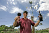 Wine maker Rainer Thoma stands under the weather station located in his vineyards at the Garfield...