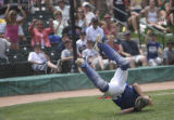 Broomfield, #9, Catcher, Jordan Kessler, makes a dramatic catch for an out late in the game....