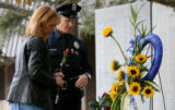 Fallen Denver Police officer Donald Young's wife Kelly Young, cq, and his partner, Denver Police...