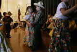 Edith Flores smiles as she dances with her partner Cesar Lopez both 7 (cq teacher) and from...