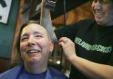(DENVER, Colo., March 17, 2005) Shelly Cote from Denver, reacts as she gets her head shaved by...