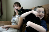 Tanner Segura, 8 holds his cat Jared, as his mother, Lisa Gramling, looks on Sunday May 7, 2006. A...